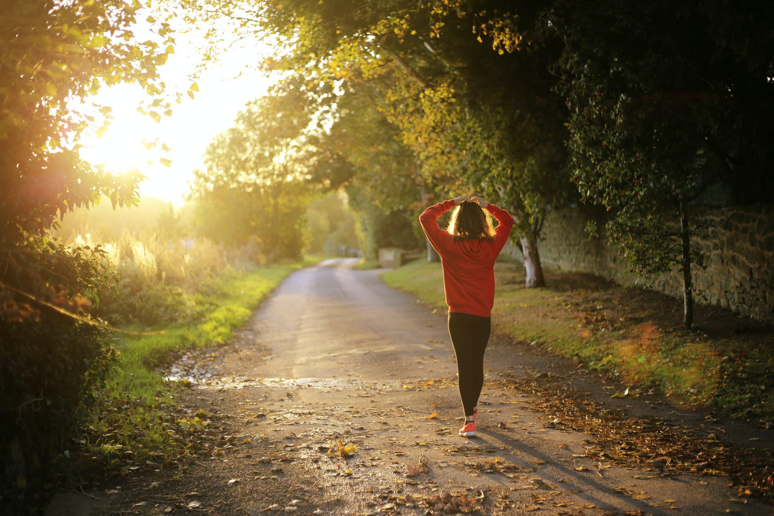 Woman walking on nature trail